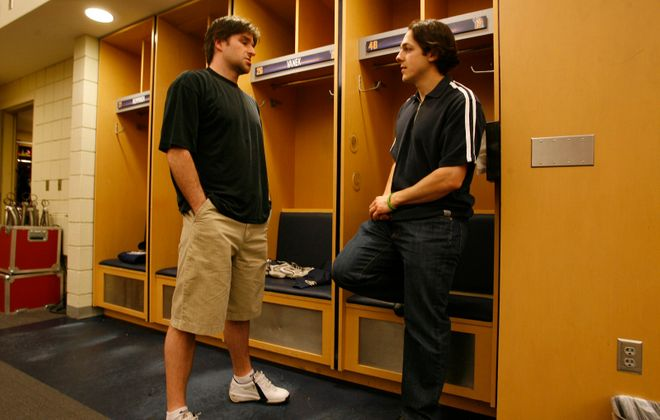 Buffalo Sabres co-captains Chris Drury and Daniel Briere talk in the locker room after exit physicals and interviews as the Buffalo Sabres cleaned out their lockers at HSBC Arena in 2007. (Harry Scull Jr./News file photo)