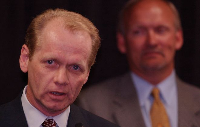 Sabres GM Darcy Regier speaks during Sabres news conference on 5/28/03 with coach Lindy Ruff on his left. (News file photo)