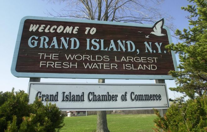 A sign welcoming visitors to Grand Island, which is not the world's largest freshwater island. (Photo by Derek Gee)