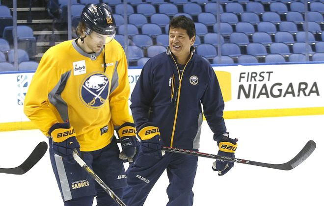Sabres head coach Ted Nolan, here with Marcus Foligno, signed a three-year deal to stay in his job on Monday.