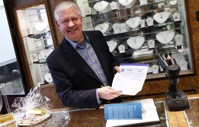 Todd Scanlon of Scanlon Jewelers shows his diamond certificate from the European Gemological Laboratory on Friday in Williamsville. Such certificates are also provided by the Gemological Institute of America, providing authenticity to the diamond purchase.
