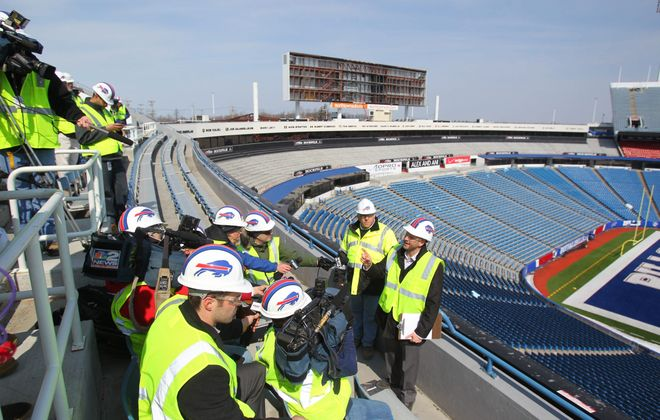 Marc Honan, the Bills' vice president for marketing and broadcasting, makes a point Tuesday as he and Joe Frandina, to his right, director of construction management, conduct a tour for reporters showing progress of the $130 million in renovations at Ralph Wilson Stadium.