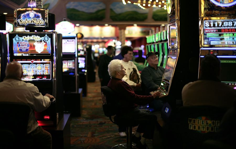 Elderly gamblers work the slot machines at a parlor in Tioga Downs, near Nichols, N.Y. Bus trips from senior centers are a commonly offered form of entertainment.