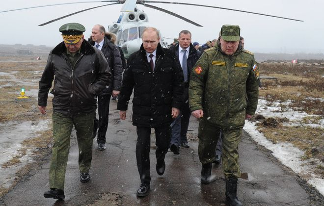 Russian President Vladimir Putin, center, and Defense Minister Sergei Shoigu, left, and the commander of the Western Military District Anatoly Sidorov, right, prepare to watch military exercise near St.Petersburg, this week. Europe needs to take a leading role in responding to Russia's incursion into Ukraine.