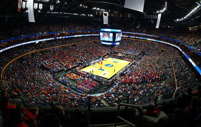 A jam-packed First Niagara Center is center stage for the NCAA Men's Basketball Tournament as Ohio State University and Dayton do battle Thursday. Dayton prevailed over its instate rival in a thrilling upset that set the tone for further excitement.