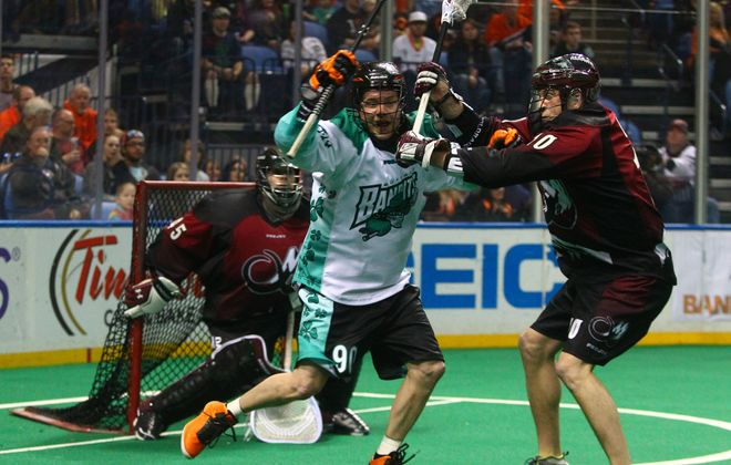 The Bandits' Jamie Rooney (90) looks for opening against Colorado's Colton Clark during Saturday's game at First Niagara Center.