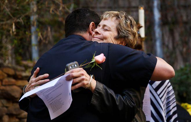 Austin Police Chief Art Acevedo, left, and a festivalgoer hug at a vigil for victims of SXSW crash.
