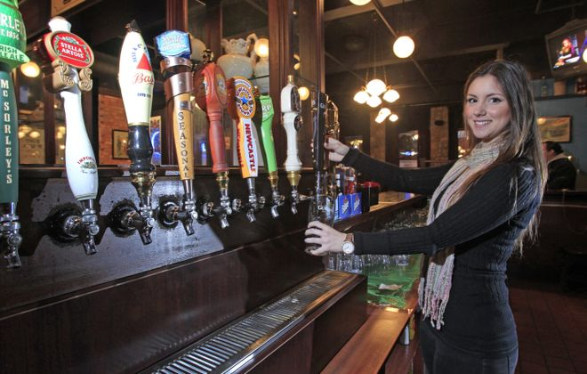 Bartender Rachel Boccard pours a Guinness in D'Arcy McGee's.