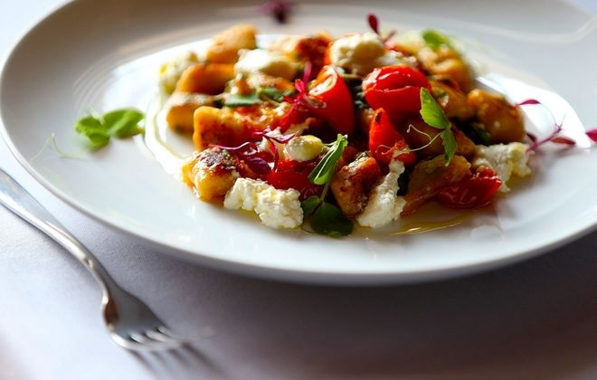 Chef Bruce Wieszala's Handmade Potato Gnocchi, with local vegetables, homemade ricotta and fresh herbs in the kitchen at Tabree on Main Street near Snyder. (Robert Kirkham/Buffalo News)