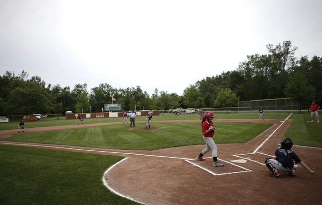 "An-Jo League kids in Lockport enjoy the fruits of George Davis' nearly decadelong labors as they compete at Harley Field, a baseball jewel he created next to the home he built. What had been dirt was transformed into grass ""like magic overnight."""