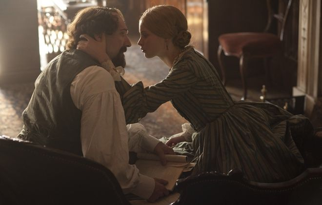 "Ralph Fiennes stars as Charles Dickens and Felicity Jones as his mistress, Nelly Ternan, in ""The Invisible Woman,"" a 2013 biopic written and directed by Fiennes."