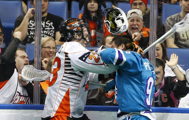 The Bandits' Steve Priolo mixes it up with Rochester's Johnny Powless at First Niagara Center.
