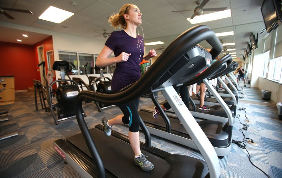 Rebekah Congden works out at a gym in Amherst in July of last year. Area residents like Congden may be able to get their insurance to contribute toward a gym membership.