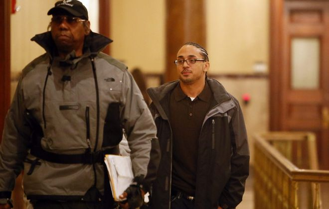 Jerome Thagard leaves the courtroom after a murder conviction for which he served prison time was dismissed in 2014. (Derek Gee/News file photo)