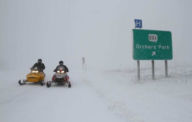 New York Park Police Sgt. Tom Krawczyk, right, and Officer Gerald Calmes were patrolling Route 219 by snowmobile at the height of Tuesday's blizzard. Police used four snowmobiles to patrol the road and check on stranded motorists Tuesday and Wednesday.