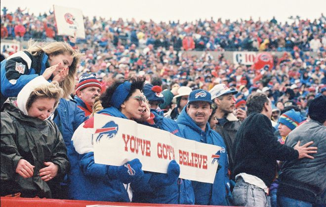 Some fans inside then-Rich Stadium hung around to watch The Comeback. (James P. McCoy/Buffalo News)