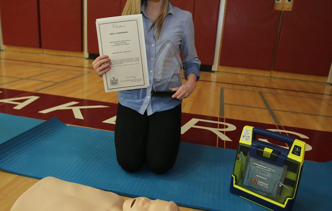 Molly Budzinski, 16, received the  Heroine of the Heart award from the American Heart Association and a proclamation from Sen. Mark Grisanti in recognition of her efforts to bring CPR training to schools in Western New York.