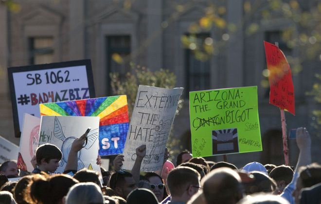 Human rights activists urged Arizona Gov. Jan Brewer to veto legislation that would allow businesses to discriminate against gays. (AP photo)