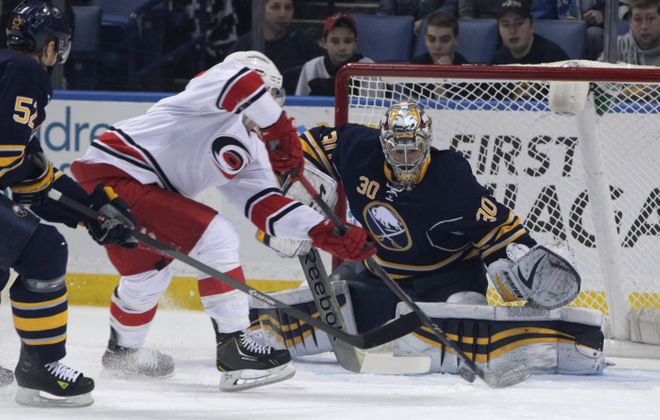 Buffalo goalie Ryan Miller makes a save on Carolina's Jeff Skinner in the first period.