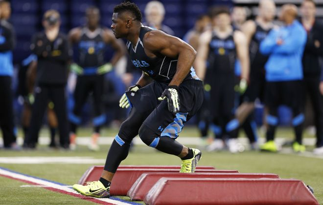 INDIANAPOLIS, IN - FEBRUARY 24: Former Buffalo linebacker Khalil Mack takes part in a position drill during the 2014 NFL Combine at Lucas Oil Stadium on February 24, 2014 in Indianapolis, Indiana. (Photo by Joe Robbins/Getty Images)