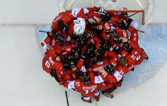 Canada's hockey players let out their emotions with a postgame celebration after defeating the Swedes, 3-0, for the gold medal in Bolshoy Ice Dome.