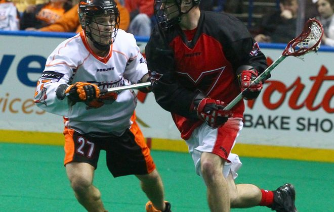 Bandits' Glen Bryan (27) covers Philadelphia's Pat Saunders (14) in Saturday night's game, won by Buffalo.