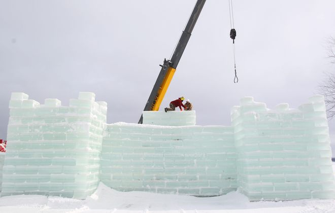 At top, Jim Bradford, left, and Tom Przepioka put blocks into place as they help build the ice castle in Mayville on Thursday. At left,  Bradford and Przepioka ice cut blocks. At center, Burl Swanson moves an ice block to the shore as he helps build the ice castle. At right, Przepioka and Bradford move the ice blocks into place. See a photo gallery at BuffaloNews.com.