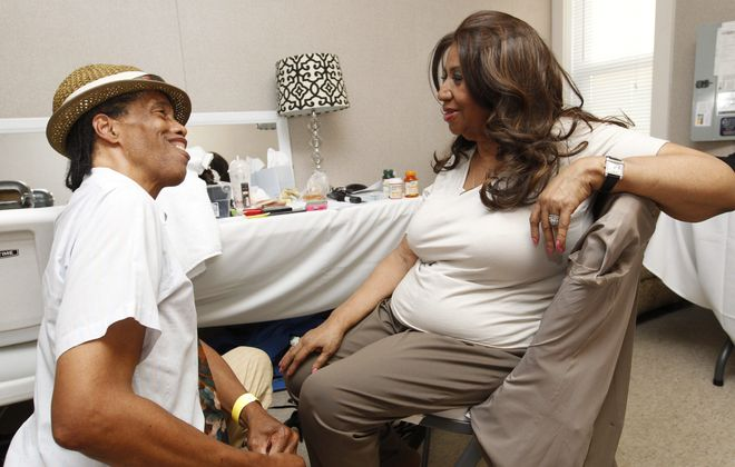 """Wayne Blassingame, of Buffalo, who grew up in the same neighborhood as Aretha Franklin, does some catching up with the """"Queen of Soul"""" before her concert Tuesday at Artpark."""