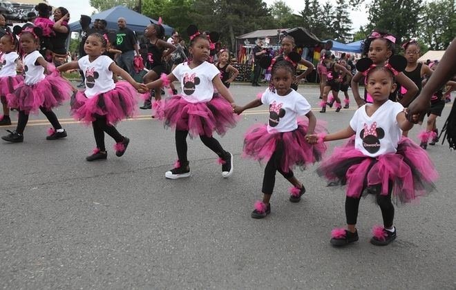 Devastation Drill Team members walk in MLK Park in the annual parade to kick off the Juneteenth Celebration in Buffalo, Saturday, June 14, 2014.  (Charles Lewis/Buffalo News)