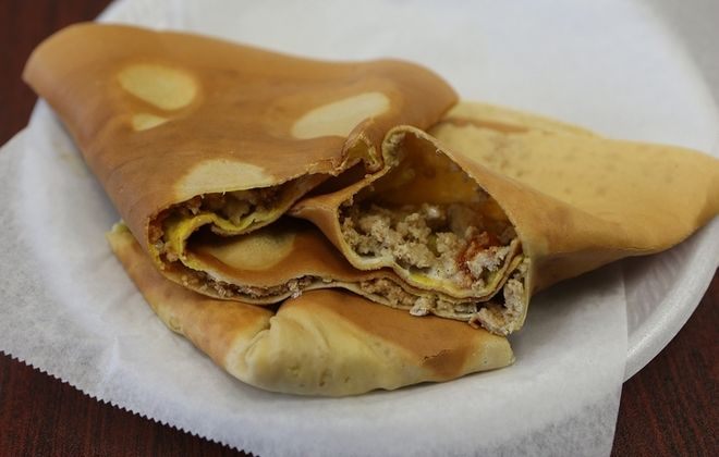The crepe, filled with Indian-spiced ground chicken, is one of the international offerings at Mohammed Yaseen's Exotic Japanese Crepes. (Charles Lewis/Buffalo News)