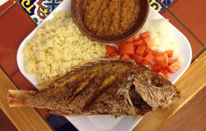 Fried fish is served with attieke, a Cote I'voreian couscous-like food made from cassava.