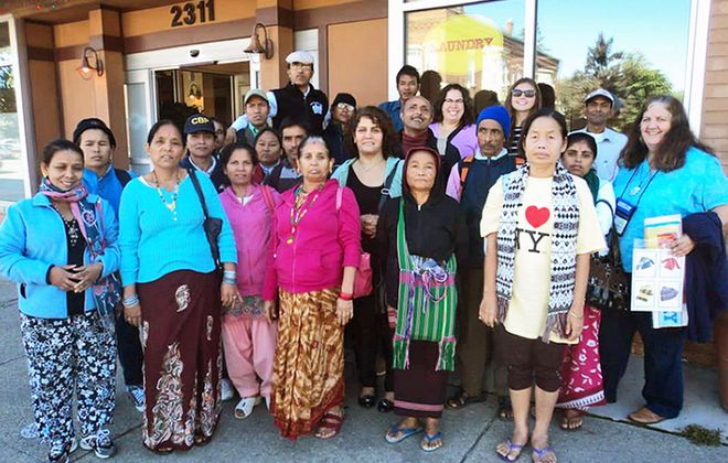 Volunteers accompany Journey's End ESL class members from Bhutan, Burma and Iraq on a visit to a local laundromat, where they learned how to use the facility and practiced language they will use there.