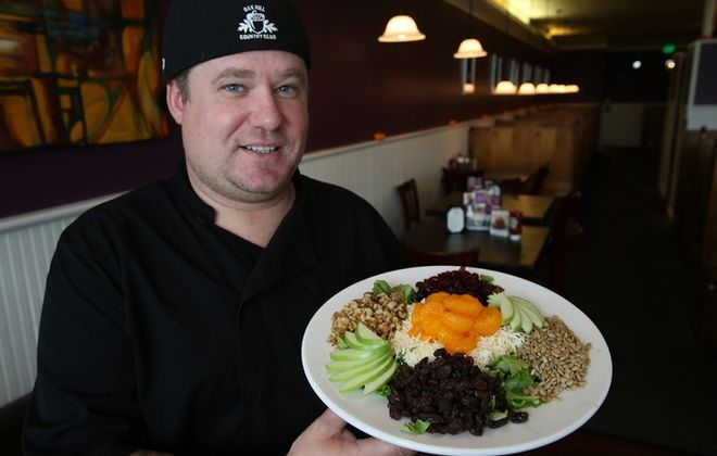 Chef Matt Powell proudly displays his Fall Harvest Salad at the Poppyseed restaurant on McKinley Parkway in Blasdell. (Charles Lewis/Buffalo News)