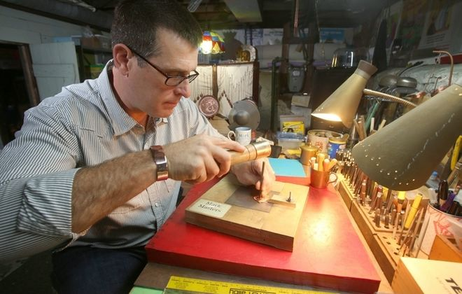 """""""Fear almost kept me from pursuing it,"""" said artist Mark Masters, shown working in the basement studio of his North Buffalo home, of the craft that has become a major passion in his life. (Robert Kirkham/Buffalo News)"""