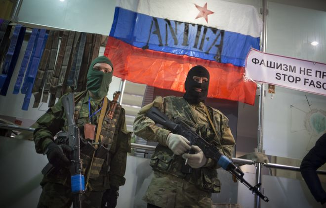 There is little doubt that the masked men taking over parts of eastern Ukraine are Russian soldiers sent there by Russian President Vladimir Putin. (AP photo)
