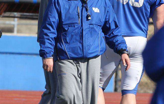 New UB defensive line coach Chris Cosh runs a drill during a recent spring football practice.