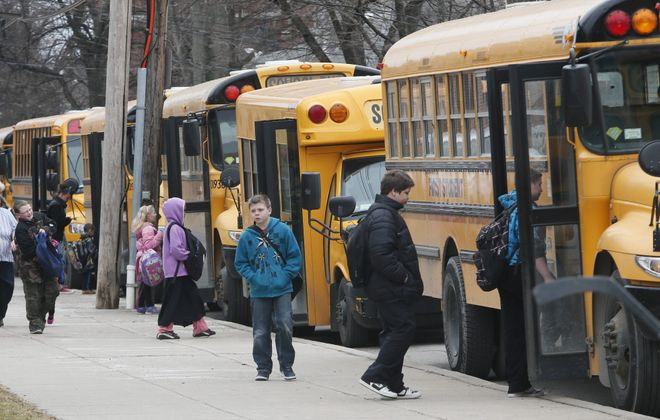 Students at Lovejoy Discovery School 43 board their buses last week. The school's racial balance shifted considerably between 2002 and 2012.