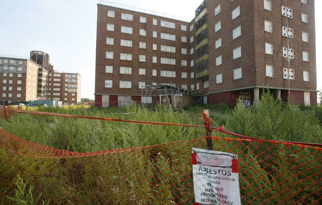 Contractor's failure to properly remove asbestos from the former Kensington Heights housing project resulted in the repeated release of asbestos into the environment.  (Derek Gee/Buffalo News file photo)
