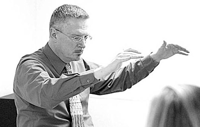 Conductor Roland Martin, pictured here conducting in 2009, leads the Freudig Singers. {Photo by Derek Gee / Buffalo News}