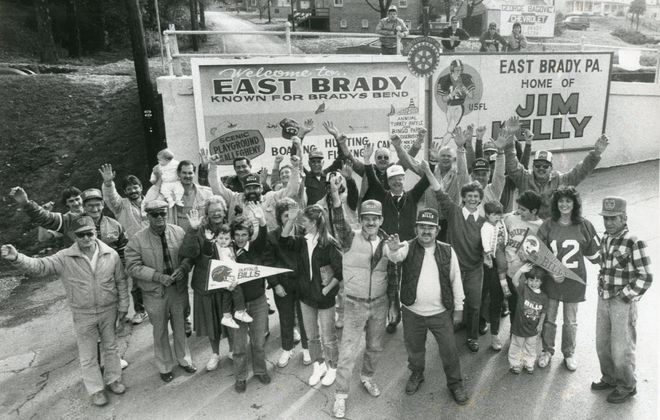 Jim Kelly's friends welcome visitors to the town of East Brady, with their favorite son depicted on the billboard, on Nov. 6, 1986. (News file photo)