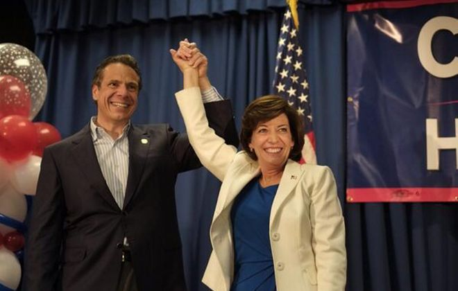 Gov. Andrew M. Cuomo and running mate Kathleen C. Hochul greet the crowd in Amherst on the first stop of their campaign.