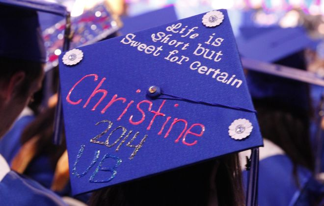 Christine Barone, of Rochester, N.Y.  wears a message on her Cap and Mortar Board as she graduates in Social Sciences Interdisciplinary at the 2014 UB Graduation ceremonies, where 5,500 students graduated today  at UB Alumni Arena  in Buffalo, N.Y., on  Sunday, May 18, 2014. (John Hickey/Buffalo News)