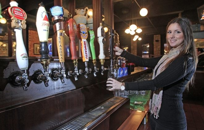Bartender Rachel Boccard pours a Guinness in D'Arcy McGee's. (Harry Scull Jr./Buffalo News)