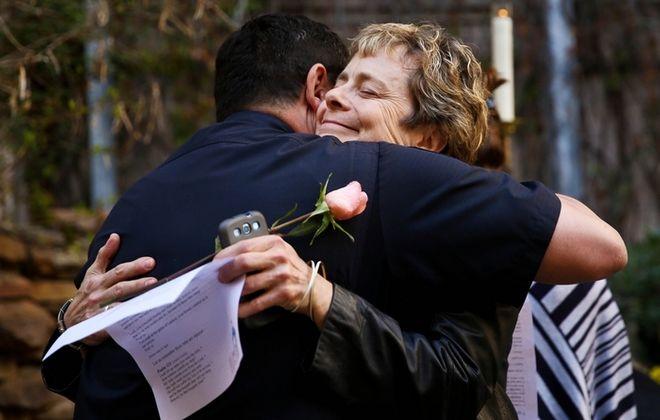 Austin Police Chief Art Acevedo, left, and a festivalgoer hug at a vigil for victims of SXSW crash. (Associated Press)