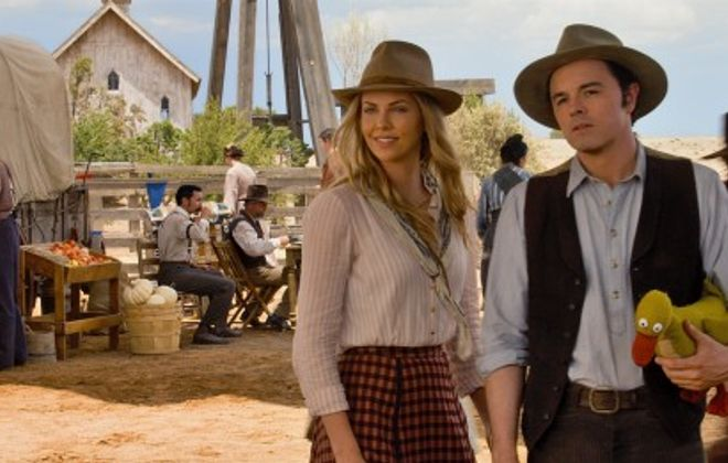 "This image released by Universal Pictures shows, Seth MacFarlane, right, and Charlize Theron in a scene from ""A Million Ways to Die in the West."" (AP Photo/Universal Pictures)"