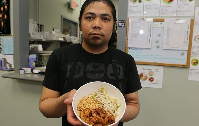 Burmese chef Soe Maung Maung displays a Shan noodle bowl at the West Side Bazaar. (Charles Lewis/Buffalo News)