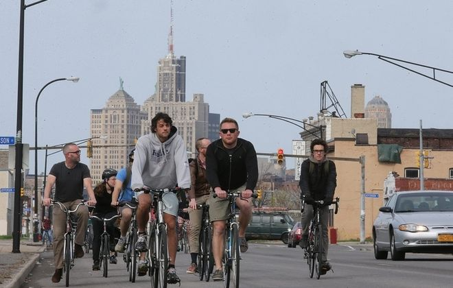"""Participants ride along Broadway in downtown Buffalo at the start of the """"Tour de Neglect"""", a bicycle tour of some deteriorating Buffalo landmarks May 10.  (Charles Lewis/Buffalo News)"""