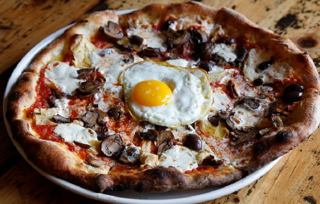 Artichoke hearts, kalamata olives, mushroom, parma prosciutto and mozzarella and a free-range egg. (Sharon Cantillon /Buffalo News)