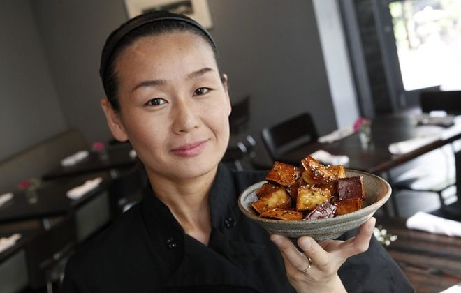 """Chef Satomi Smith, at Sato on Elmwood Avenue, presents the daigaku imo or """"college fries,""""  fried sweet potatoes coated with caramel sesame. (Sharon Cantillon/Buffalo News)"""