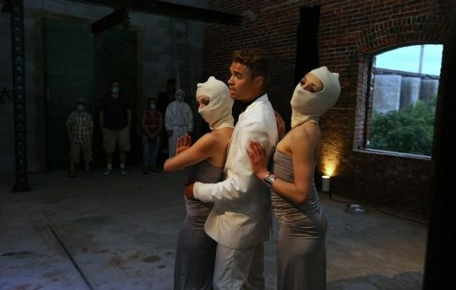 "Actors in a scene from ""Storehouse"" at Silo City in Buffalo on Aug. 21. (Charles Lewis/Buffalo News)"